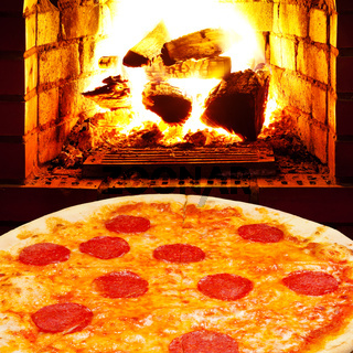 pizza with salami and open fire in stove