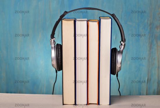 Headphones and books symbolize audio books