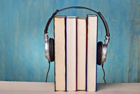 Headphones and books symbolize audio books
