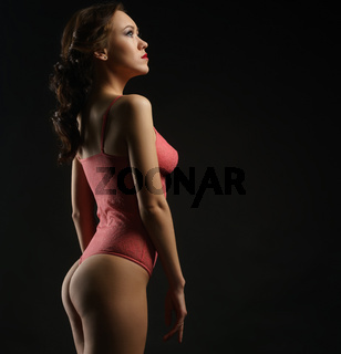 Beautiful girl posing in her profile in studio.