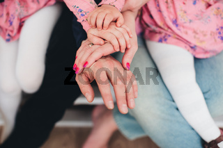 Family hands of four, mother, father and 2 kids