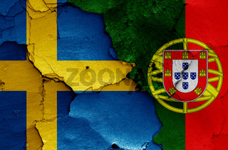 flags of Sweden and Portugal painted on cracked wall
