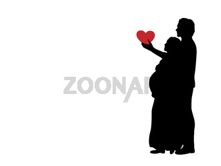 Silhouette loving husband gives heart beloved pregnant wife.