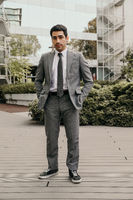 Vertical portrait of confident and successful young businessman. Outdoor.