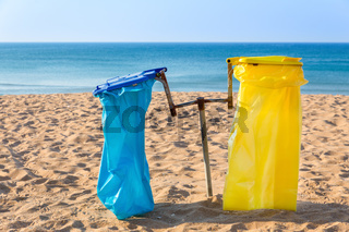Garbage bags on  coast with beach and sea