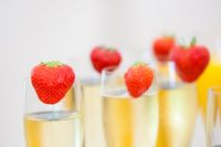 Glasses of sparkling wine or champagne and strawberry