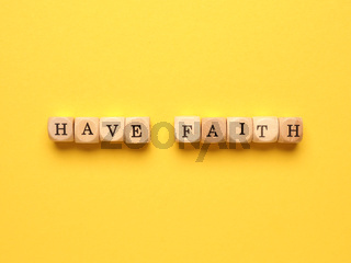 Have faith written with small wooden blocks