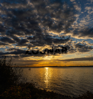 Sunset on the beach of Heikendorf in Schleswig-Holstein, Germany at sunset in autumn