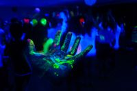 Hand with a fluorescent paint