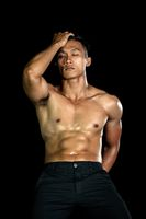 Muscle bodybuilder asia men posing muscle front on the black background. Body gym big chest and shoulder. Fashion style