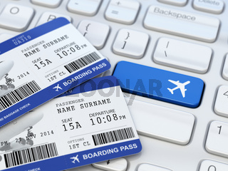 Online ticket booking. Boarding pass on laptop keyboard.