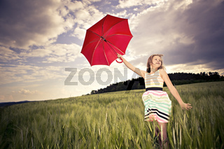 jumping girl with umbrella
