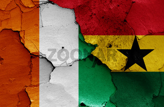 flags of Ivory Coast and Ghana painted on cracked wall