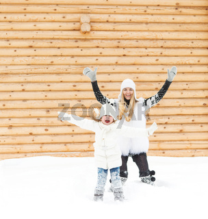 Happy mother with her daughter jumping outdoors