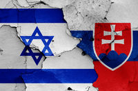 flags of Israel and Slovakia painted on cracked wall