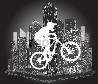 Silhouettes of cyclists on the background of city