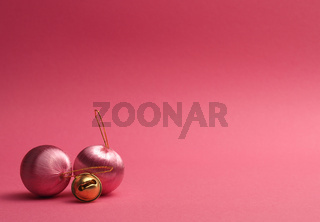 Pink vintage Christmas baubles on a pink background