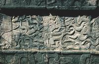 Closeup of carved Maya figures in a Mayan temple in Chichen Itza, Yucatan, Mexico