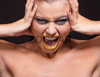 attractive young woman scream out loud with yellow lipstick