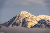 Majestic peak of Mount Timpanogos with blanket of snow on a cold winter day