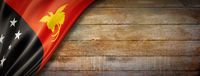 Papua New Guinea flag on vintage wood wall banner