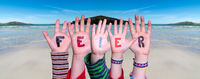 Children Hands Building Word Feier Means Celebration, Ocean Background