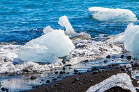 Ocean surf brings ice floes