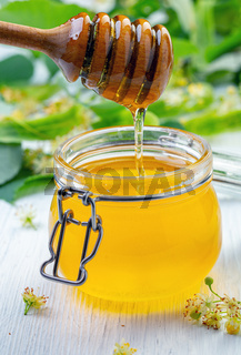 Pouring aromatic honey into jar.