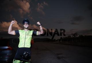 triathlon athlete portrait while resting on bike training