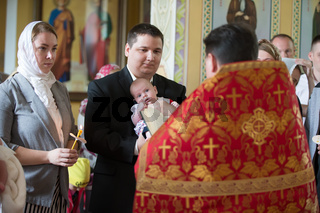Belarus, Gomel, May 6, 2018. Church of Volotovo. Godparents in the church at the baptism of a newborn child. Orthodox baptism