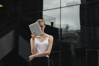 Portrait of business woman holding a tablet computer.