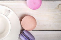 Macaroons and coffee cup closeup top view