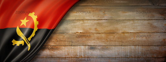 Angolan flag on vintage wood wall banner