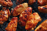 Chicken buffalo wings cooked on BBQ grill