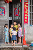 Happy children playing outside their home in China