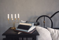 Retro candle holder and typewriter in bedroom