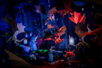 Cheshire cat and other colorful hanging toys. Flying characters from fantasy movies of magic on a shallow depth of field