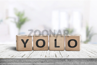 Yolo abbreviation sign in a bright living room