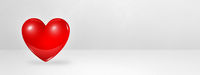 3D red heart on a white studio banner