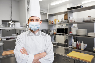 male chef cook in face mask at restaurant kitchen