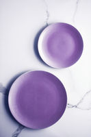 Purple empty plate on marble table background, tableware decor for breakfast, lunch and dinner for restaurant brand menu recipe, luxury holiday flatlay design