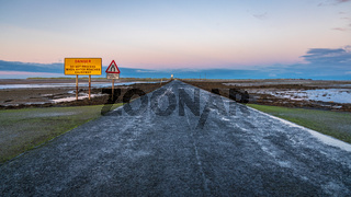 Sign: Single File Traffic, Danger do not proceed when water reaches causeway