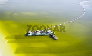 aerial view of salt mining ship on salt lake