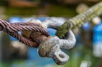 A shackle connects steel rope and line