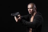 man shooting gun isolated on black background
