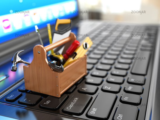 Online support. Toolbox with tools on laptop.