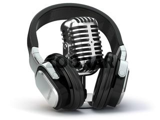 Vintage microphone and headphones. Concept audio and studio recording