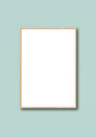 Wooden picture frame hanging on a light blue wall