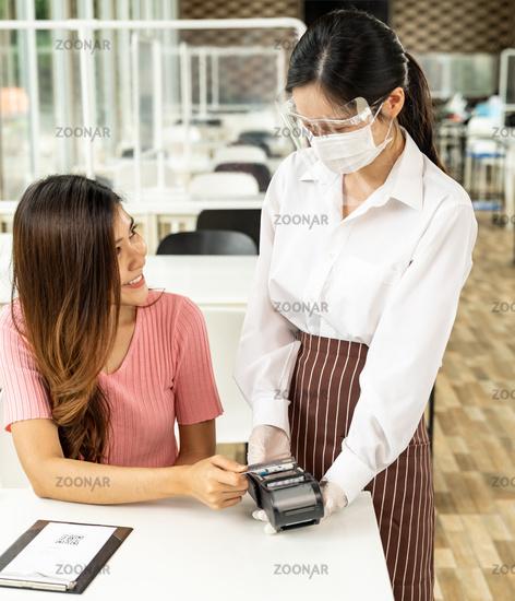 Asian customer make contactless credit crad payment