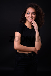 Portrait of young beautiful Persian teenage girl with curly hair